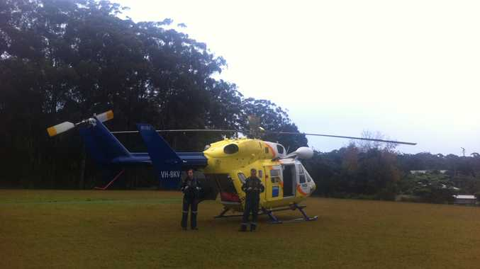 The RACQ Rescue helicopter lands at Mapleton Falls National Park to help a seriously ill bushwalker.