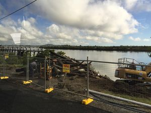 Deteriorating piers demolished by crews on River St