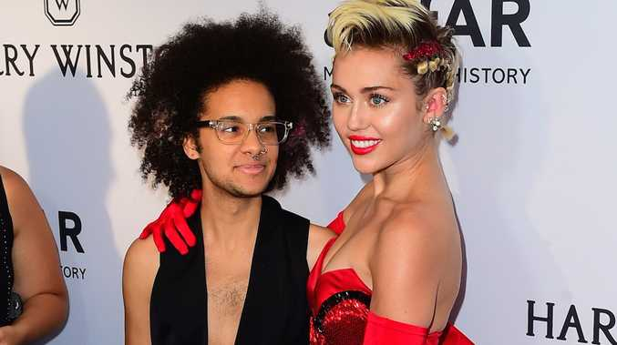 Tyler Ford and Miley Cyrus at the amfAR Inspiration Gala