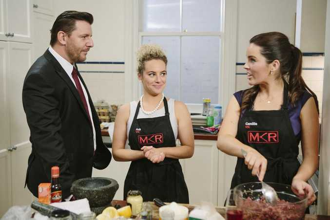 My Kitchen Rules contestants Ash and Camilla pictured with judge Manu Feildel during their instant restaurant.