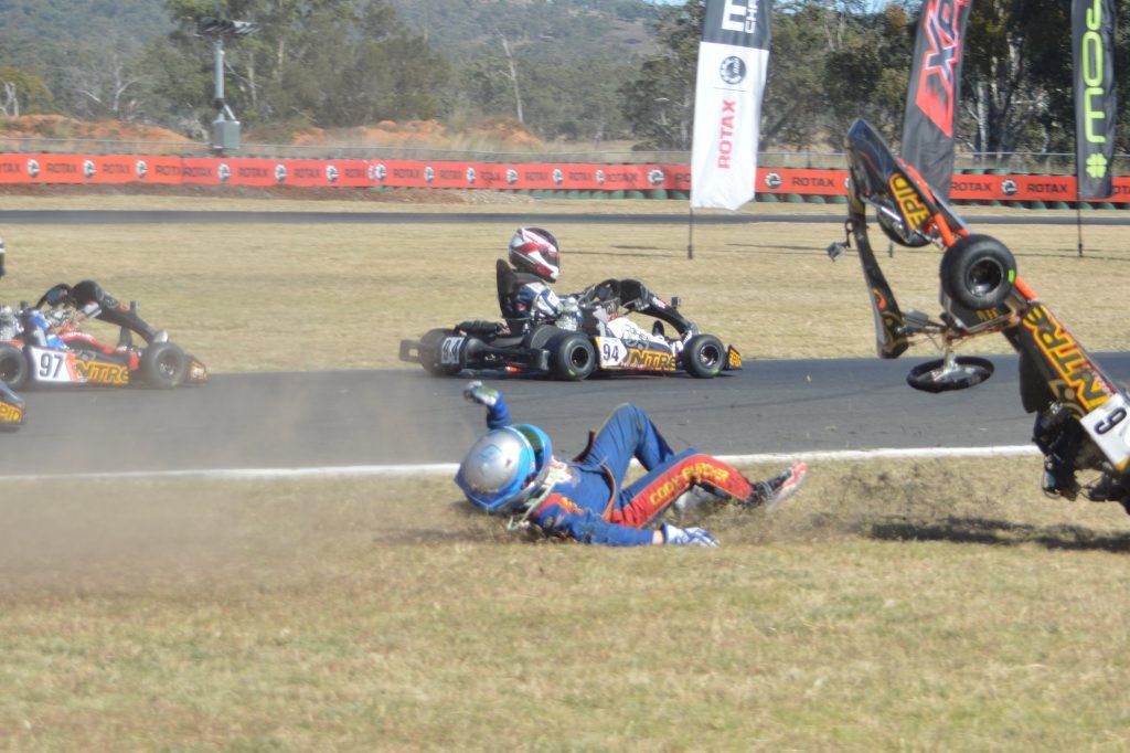 Orange driver Cody Burcher after a spill. Photo Kev Davies Sports Photography