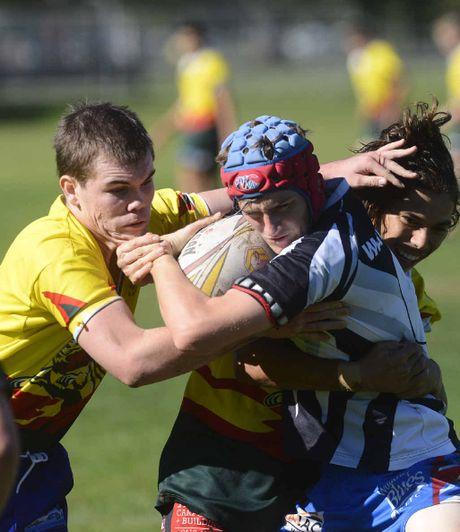 South Grafton's Brock Rediger and Jordan Child tackle a Wauchope player in University Shield. PHOTO: ADAM HOURIGAN