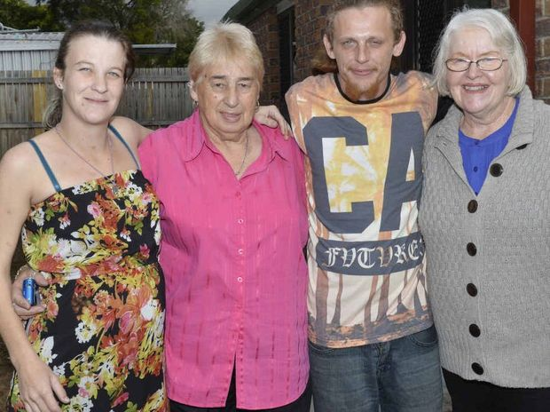 BIG SMILES: Charmaine Peck and Jamie Robinson lost their home in a house fire. Vivienne Stanbury and Judith Van de Pol from Goodna Services Club Community Support Group have helped out with $2700 in donations.