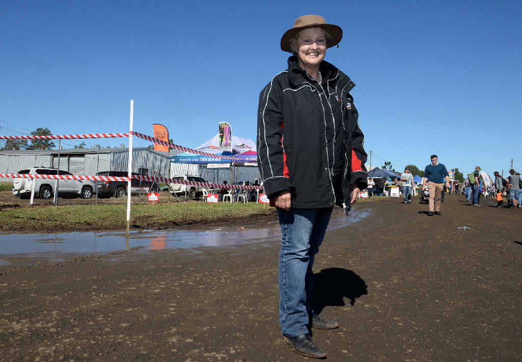 SUNNY: Fairfax Rural Events group manager Kate Nugent at Primex, Casino, yesterday and, below, Brown and Hurley salesman Drew Anderson in a rare Kenworth K200. Only 50 of the delux trucks were made.