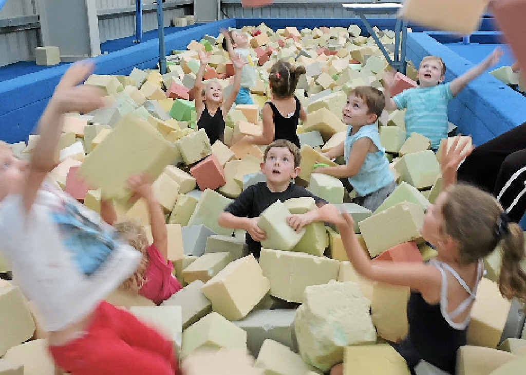 Children in the four to six-year-old gymnastics group Lenny Buckley, Elle Upton, Samuel Martin, Bridget Boland, Fred Miller (centre), Hunter Steler, Caiden Reynolds and Charlie Smith love the new foam pit.
