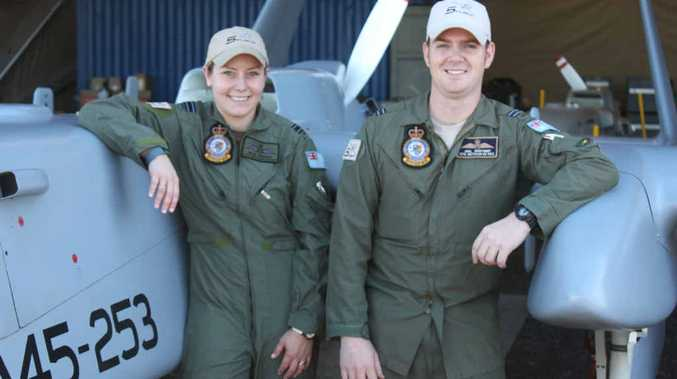 FLYING HIGH: Flight Lieutenant Janelle Sheridan and Flight Lieutenant Joel Mortimer with the Heron remotely piloted Unmanned Aircraft System, which will be flown in civilian airspace for the first time next week.