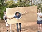 With one of the portholes ready for painting are (from left) Riley Meara, Hamish Williams and Will Roberts as staff, students and parents of Toowoomba Grammar School and Fairholme College recreate the Titanic for a musical to be presented next term.