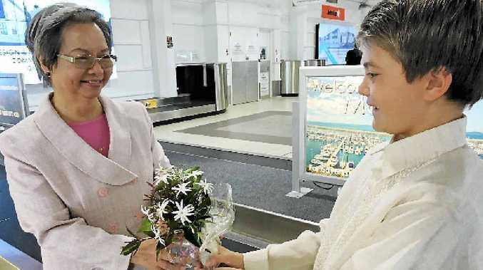 WARM WELCOME: Ambassador Belen F. Anota receives the Philippine national flower sampaguita from Natan Gooch at Mackay Airport.