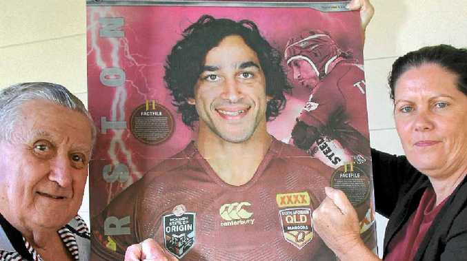 FRIENDLY RIVALRY: Ray Grace laminated the Sunshine Coast Daily's life-sized poster of Jonathan Thurston and put it up in the Bendigo Bank Woombye to 'gee-up' NSW fan Pauline Healey.