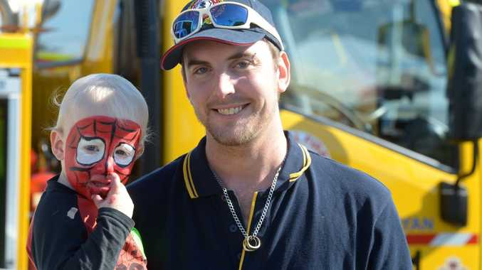 OPEN DAY: Trent Petterson and his son Lachlan Petterson at the Branyan Rural Fire Brigade Open Day. Photo: Max Fleet / NewsMail