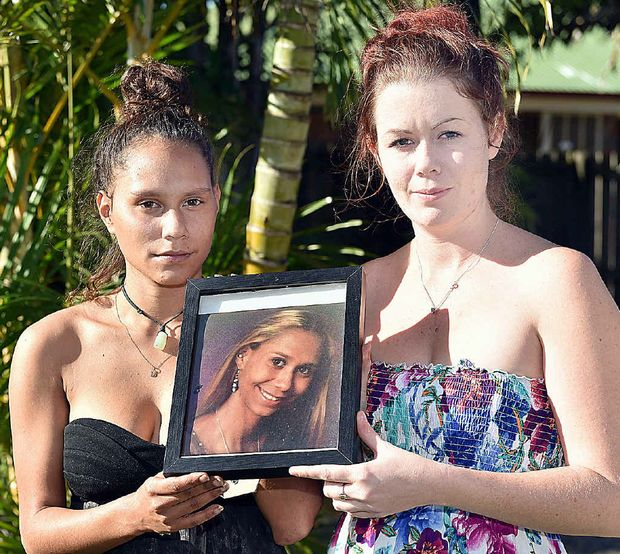 WHERE IS MONIQUE: Hervey Bay's Minnie Clubb and Nikki Duncan with a photo of Monique Clubb, who went missing two years ago today.