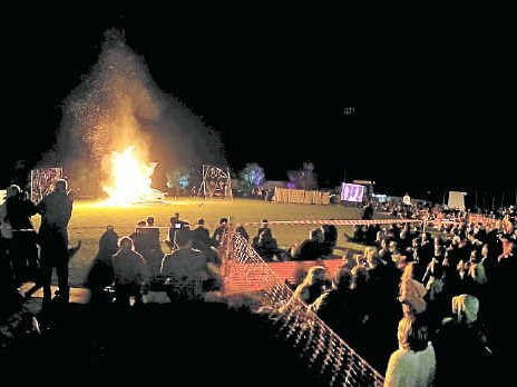 GRAND FINALE: Thousands of residents watching the bonfire to top off the night.