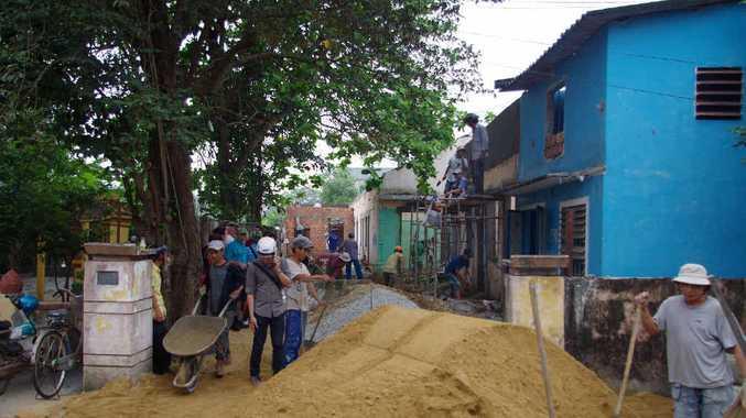 Volunteers start work on a Project Vietnam site.