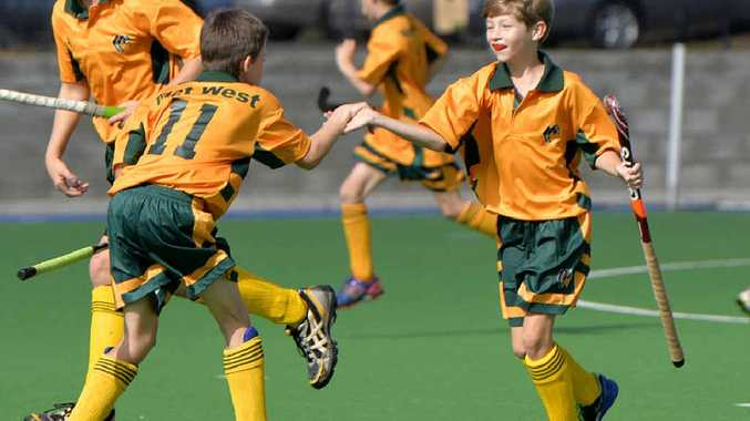 WELL DONE: Met West boys celebrate some fine work during the 10-12 years state titles in Ipswich.