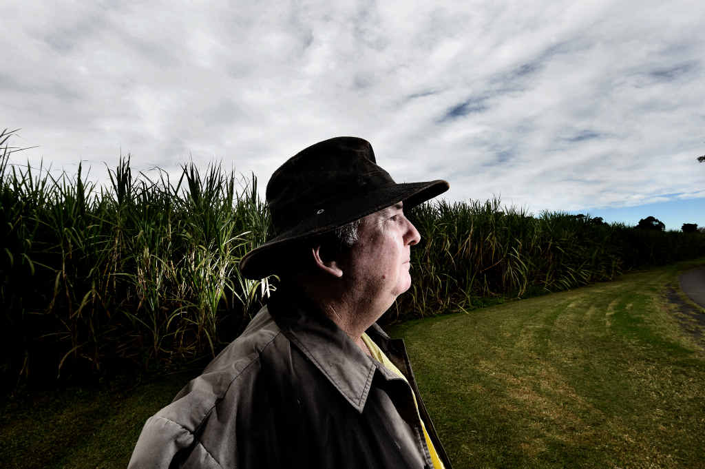 OVER-RUN: Broadwater cane farmer Mark Byrne is concerned by plans to run a highway through the middle of his cane plantation.