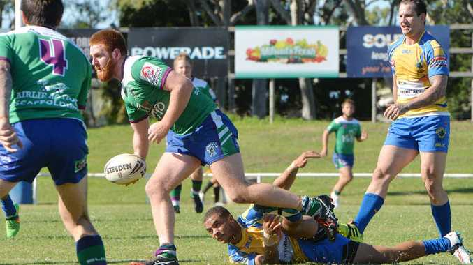 BIG EFFORT: Whitsunday Brahmans' Dane Vardanega tries to offload during his team's two-point win against Souths Sharks in Mackay yesterday. Souths drew close late but the Raiders managed to hold on for victory.