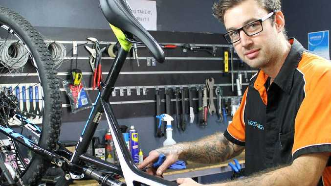KEEP SECURE: Bikes on High store manager Benjiman Hubbard takes a look over a new set of wheels.
