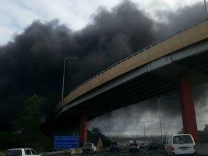 Dozen crews called in to battle warehouse blaze