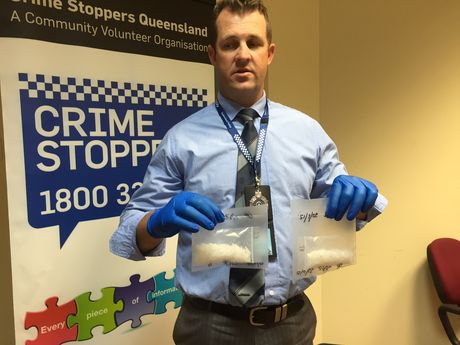 Gladstone Criminal Investigation Branch Officer in charge Detective Senior Sergeant Luke Peachey with the ice seized from a 24 year old woman today.