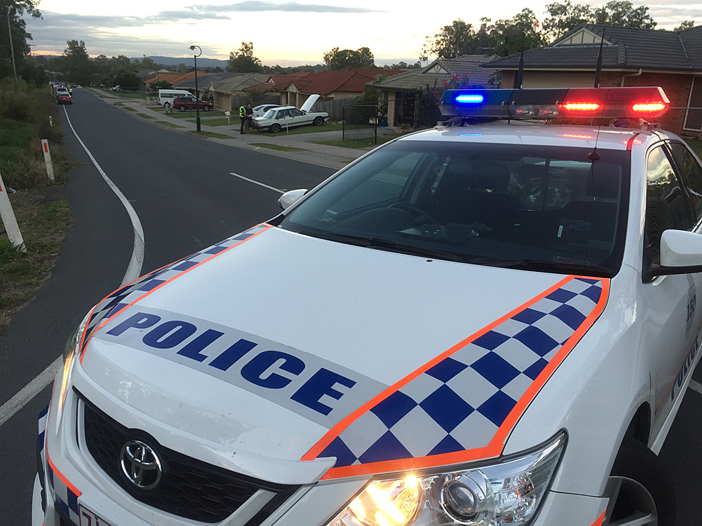 Police have a taken man into custody after an altercation near the intersection of Albert St and Storr Cct at Goodna.