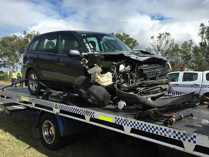 Police remove a vehicle from a crash site on Ipswich-Boonah Rd at Purga.