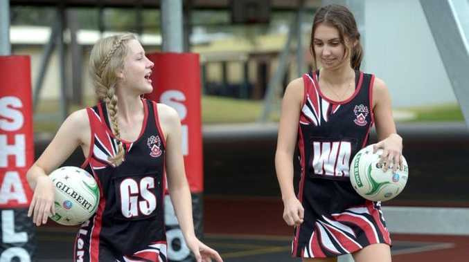 SPORT REPS: Shalom College students Laura O'Sullivan and Dayna Hammermeister are proud to represent their school. Photo: Max Fleet / NewsMail