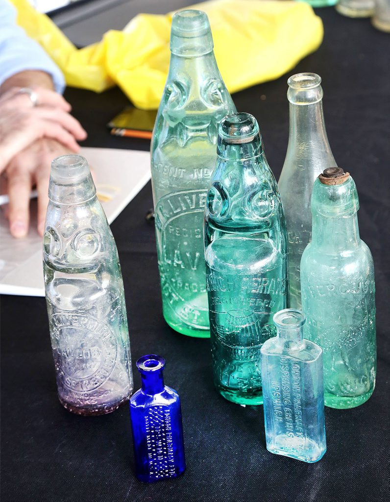 Rare Ipswich bottles unearthed at a free appraisal with antique dealer Joel for the Bottle Alley mural project. Photo: Contributed