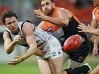Shane Mumford and Dylan Shiel of the Giants apply pressure to Patrick Dangerfield of the Crows as he hand balls during the Round 8 AFL match between the Greater Western Sydney Giants and the Adelaide Crows at Spotless Stadium in Sydney, Saturday, May 23, 2015. (AAP Image/Dean Lewins) NO ARCHIVING, EDITORIAL USE ONLY
