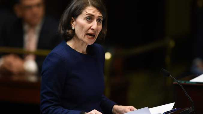 NSW Treasurer Gladys Berejiklian delivers her first budget to the NSW Legislative Assembly in Sydney on Tuesday, June 23, 2015. (AAP Image/Paul Miller) NO ARCHIVING