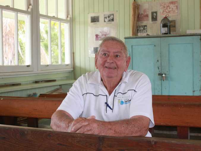 Vince Reynolds sits in the former Kalapa School, which is now located at the Rockhampton Heritage Village. Photo Michelle Gately / Morning Bulletin