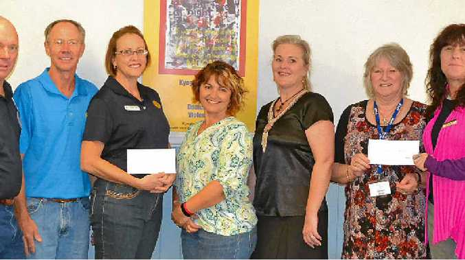 MONEY HANDOVER: Kyogle Rotary's Peter Clarke, Mark Ivanusa and Michele Sabol with Express Examiner editor Samantha Elley, Kyogle mayor Danielle Mulholland and Kyogle District Domestic Violence Committee's Jacqueline Barton and Nicola Mercer.