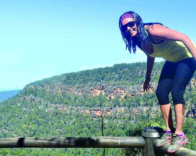 LUCKY ESCAPE: Meagan Dempster has relived her incredible rescue after she slipped and fell onto a cliff face while backpacking at Springsure on Sunday.
