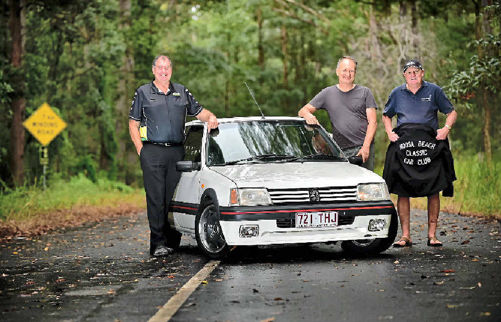 REVVED UP: Paul Holter of Autobarn Gympie, Noel St. John-Wood and Wally Conway of Noosa Beach Classic Car Club with a Peugeot 205 GTi competitor at the base of Gyndier Dr, Tewantin, where the Autobarn Gympie Noosa Hill Climb will take place in July.