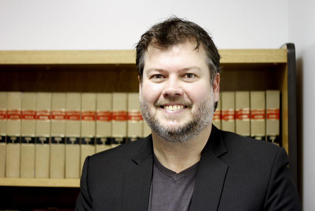 Alex McKean is a successful landscaper turned barrister.