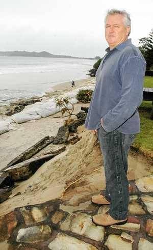 LONG HISTORY: Belongil Beach resident John Vaughan at his erosion-damaged property.