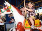 Amanda Ramsay and her son TJ Ramsay have a ride on the Merry-go Round at the Mackay Show.