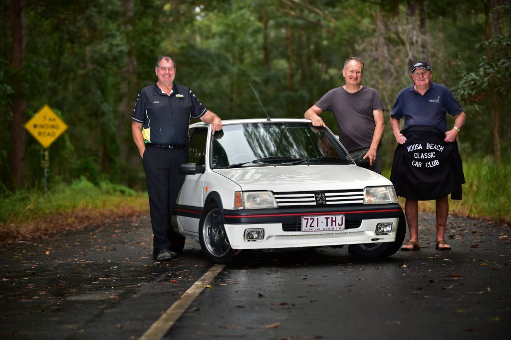 (left) Paul Holter of Autobarn Gympie, Noel St.John-Wood and Wally Conway of Noosa Beach Classic Car Club with a Peugeot 205 GTi competitor at the base of Gyndier Drive, Tewantin, where the Autobarn Gympie Noosa Hillclimb will take place in July. Photo: Iain Curry / Sunshine Coast Daily