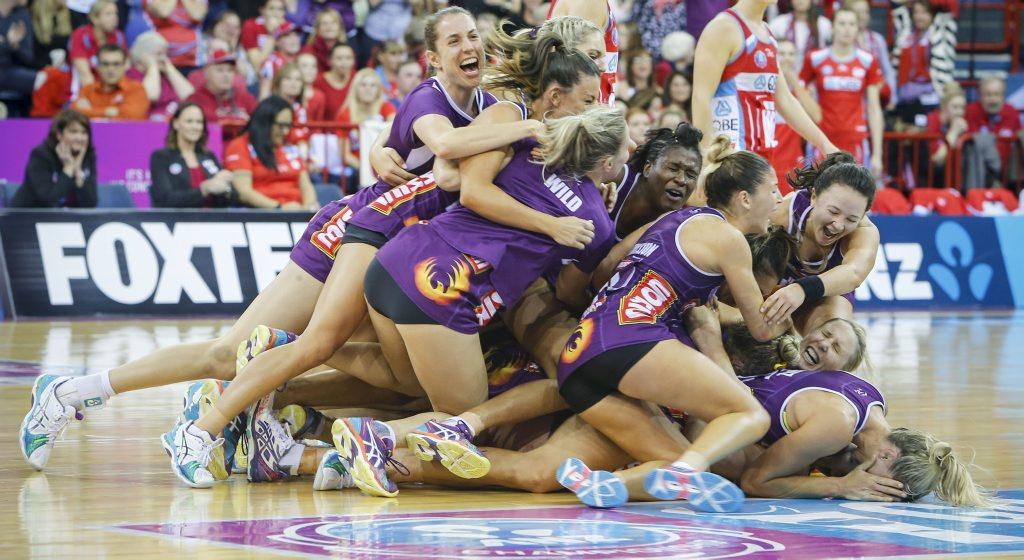 The Queensland Firebirds celebrate after winning the Netball Grandfinal between the Queensland Firebirds and NSW Swifts in Brisbane, Sunday, June 21, 2015.
