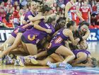 The Queensland Firebirds celebrate after winning the Netball Grandfinal between the Queensland Firebirds and NSW Swifts in Brisbane, Sunday, June 21, 2015.