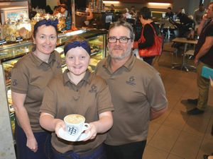 New owners Christene Woods and Adam Stephenson with Kiera, 12, at Jamaica Blue in Kin Kora's Stockland Shopping Centre.