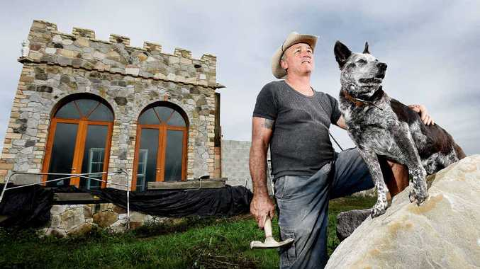 HEART OF STONE: Chris Mackie, a stonemason with 30 years' experience, and his partner Sharon are building their dream sandstone home, complete with a tower and rampart, at Tatham, south-east of Casino.