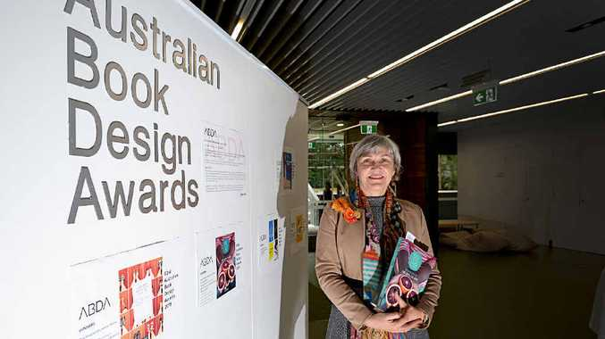 JUDGED BY THE COVER: Southern Cross University Lismore campus library manager Alison Slocombe with two of the books in the Australian Book Design Awards sponsored by the university.