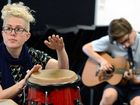 Singer Katie Noonan with St Patricks College student Oliver Carter-Beck joins in the playing at a songwriting workshop in Mackay.