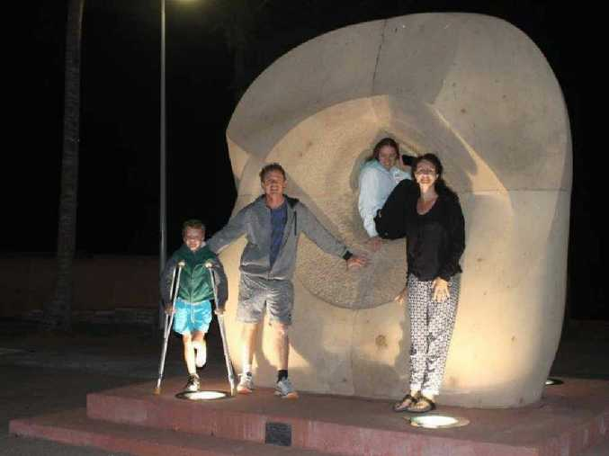LIGHT IT UP: Cr Adam Belot and his family check out the new lights on Yeppoon's foreshore.