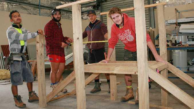 BRIDGE BUILDERS: Construction students Sathaphon Chanhom, Kalani Heke, Darren Holmes and Alex Shields work on the new play bridge for Narnia Kindergarten.