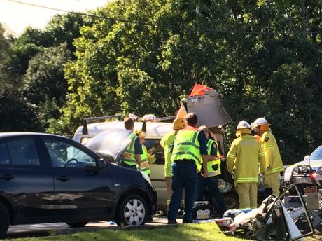 Firefighters rescue man from two car crash Dalton Dr, Maroochydore