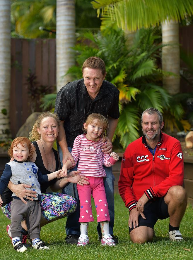 Luke Bordess (right) is cycling 1500 kms to help raise money for Jameela Cox-Bowden injured in an accident . Proud parents Jason Bowden and Carolyn Cox with 2 year old son Cayden are supporting the charity ride.