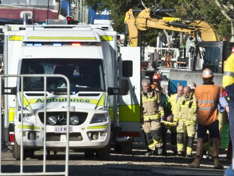 Emergency services at the QIC development site in the Toowoomba CBD where a worker has been crushed by a metal pole.