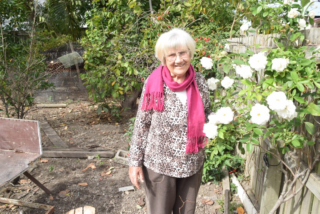 BLOOMIN' BEAUTIFUL: Maisie Clarke shows off her white roses that have bloomed better than she has seen in five years.