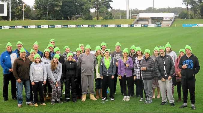 RUGGED UP: 45 Coffs Coast residents braved wet and windy conditions for the second annual C.ex Community Crew Sleep Out. Contributed